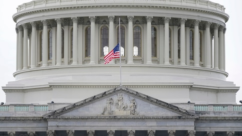 An American flag flies at half-staff in remembrance of U.S. Capitol Police Officer Brian Sicknick above the Capitol Building in…