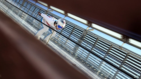 Canada's Natalie Eilers starts for the women's ski jumping normal hill individual 1st round at the FIS Nordic World Ski…