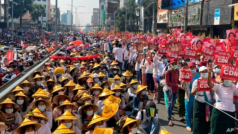 Anti-coup protesters fill the main road during a rally in Mandalay, Myanmar Monday, Feb. 22, 2021. A call for a Monday general…
