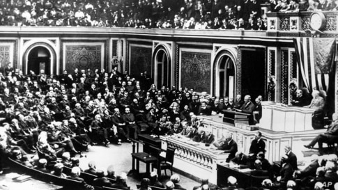 President Woodrow Wilson delivers a speech to a joint session of Congress in Washington on April 2, 1917, just days before…