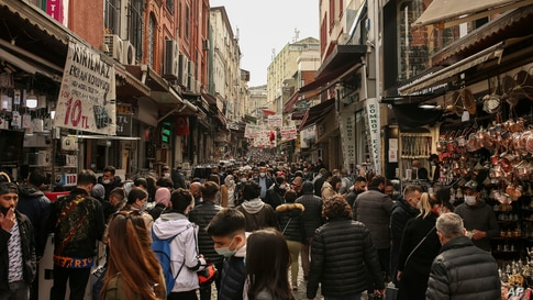 People walk in Eminonu open market in Istanbul, Friday, April 2, 2021. The number of confirmed COVID-19 cases in Turkey…