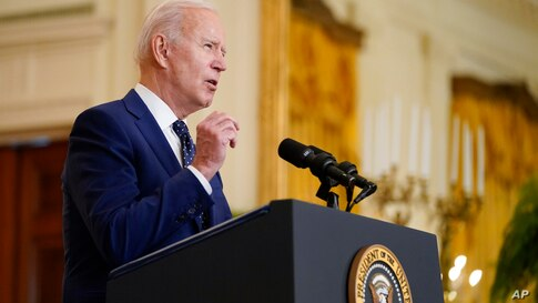 President Joe Biden speaks about Russia in the East Room of the White House, Thursday, April 15, 2021, in Washington. (AP Photo…