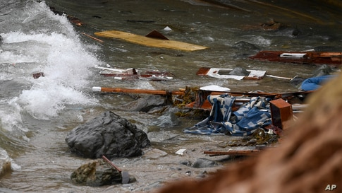 Wreckage and debris from a capsized boat washes ashore at Cabrillo National Monument near where a boat capsized just off the…