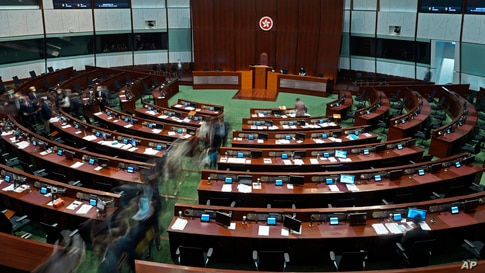 """Pro-China lawmakers leave the chamber after the """"Improving Electoral System (Consolidated Amendments) Bill 2021"""" was passed, at…"""