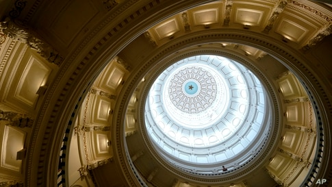 A visitor leans over a railing in the rotunda at the State Capitol, Tuesday, June 1, 2021, in Austin, Texas. The Texas…