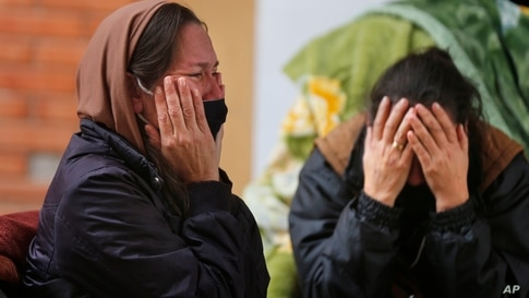 The daughters of Isidra Coronel cry after she died of COVID-19 at Hospital de Clinicas in San Lorenzo, Paraguay, Friday, June…