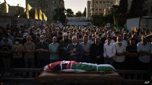 Palestinian mourners pray during the funeral of Diana Abu Al-Ouf, 46, who died today in a hospital in Israel where she was…