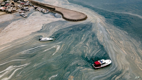 In an aerial photo, boats are seen near the Caddebostan shore, on the Asian side of Istanbul, Monday, June 7, 2021, with a huge…