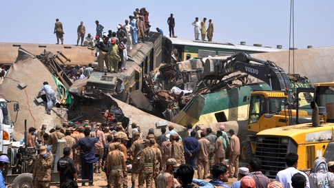 Soldiers and volunteers work at the site of a train collision in the Ghotki district in southern Pakistan, Monday, June 7, 2021…