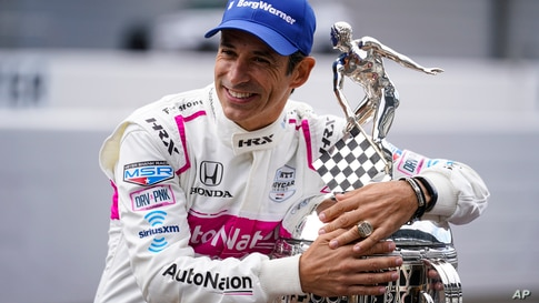 Helio Castroneves of Brazil, winner of the 2021 Indianapolis 500 auto race, poses during the traditional winners photo session…