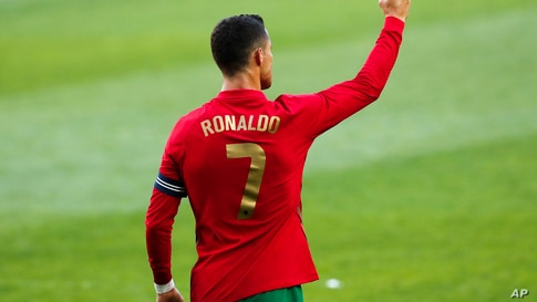 Portugal's Cristiano Ronaldo celebrates after scoring his side's second goal during the international friendly soccer match…
