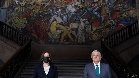 Vice President Kamala Harris poses for a photo with Mexican President Andres Manuel Lopez Obrador, Tuesday, June 8, 2021, at…