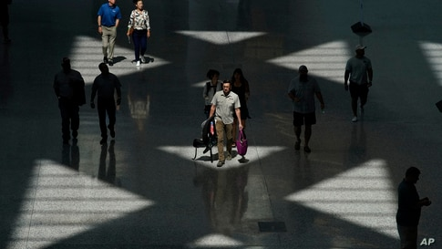 People walk through a new addition to the Las Vegas Convention Center during the World of Concrete convention Tuesday, June 8,…