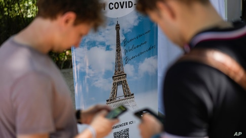 Visitors register for COVID-19 tests at the Eiffel Tower in Paris, Wednesday, July 21, 2021. Visitors now need a special COVID…