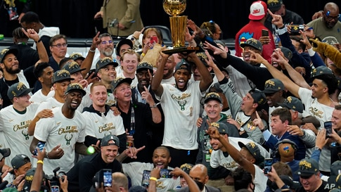 The Milwaukee Bucks celebrate with the championship trophy after defeating the Phoenix Suns in Game 6 of basketball's NBA…