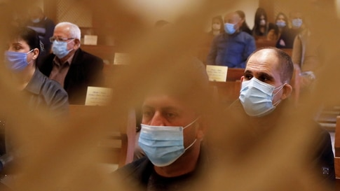 Iraqi Christians wearing protective face masks attend a mass on Christmas at St. Elya Chaldean Church in Baghdad