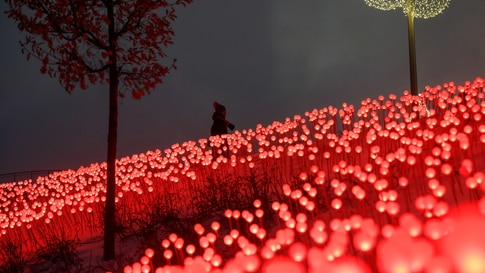 A woman walks past decorations in Zaryadye Park in Moscow