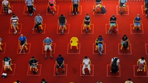 People watch an outdoor movie screening within their social distances during the coronavirus disease (COVID-19) outbreak in Singapore