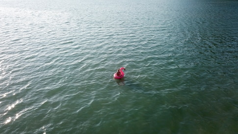 View of a lone swimmer, in Trat province, Koh Chang island
