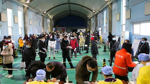 People line up to receive vaccine against COVID-19 at a sports centre in Beijing's Haidian district