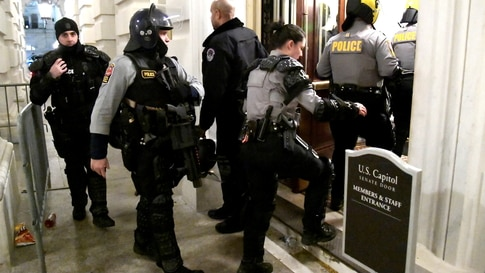 Security is upgraded in aftermath of Trump supporters breeching the US Capitol