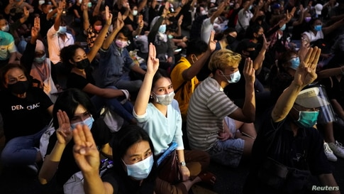 Pro-democracy protesters demonstrate in front of Royal Thai police headquarters in Bangkok