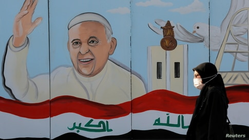 A mural of Pope Francis is seen on the wall of a church upon his upcoming visit to Iraq, in Baghdad