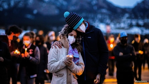 Hundreds gather for candlelight vigil after mass shooting in Boulder Colorado at King Soopers