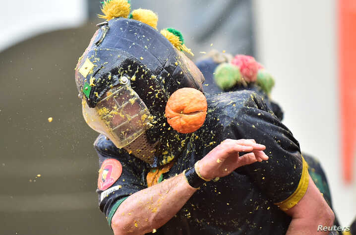 Revelers take part in a fight with oranges during an annual carnival battle in Ivrea, Italy March 3, 2019.