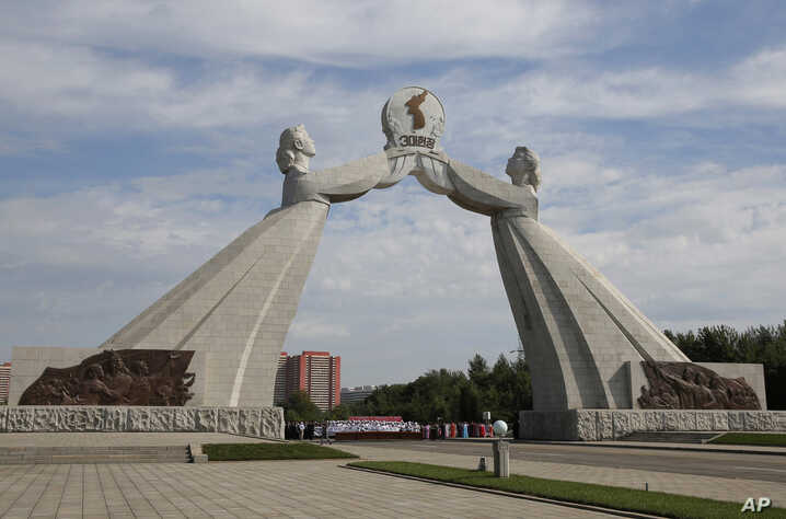 FILE - The Arch of Reunification, a monument to symbolize the hope for eventual reunification of the two Koreas, is seen in Pyongyang, North Korea, Sept. 11, 2018.