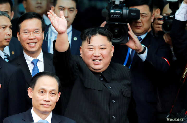 North Korean leader Kim Jong Un bids farewell to the crowd before boarding his train to depart for North Korea at Dong Dang railway station in Vietnam, March 2, 2019.