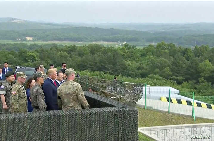 U.S. President Donald Trump and South Korean President Moon Jae-in are seen at the demilitarized zone (DMZ) separating the two Koreas, in Panmunjom, South Korea, in this still image from video taken June 30, 2019.