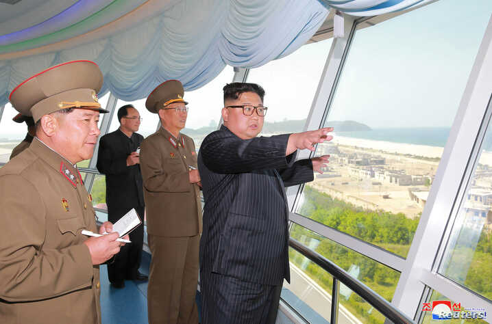 FILE - North Korean leader Kim Jong Un inspects the construction site of the Wonsan-Kalma tourist area as Kim Su Gil, third from left, new director of the General Political Bureau of the Korean People's Army, looks on, in this undated photo.