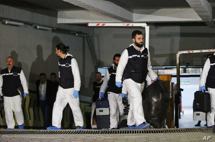 Turkish police crime scene investigators leave an underground car park, after looking for possible clues into the killing of Saudi journalist Jamal Khashoggi, on a vehicle belonging to the Saudi Consulate found by authorities a day earlier, in Istanbul, O