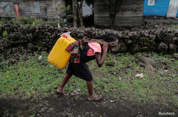Chikuru, 11, carries water on her back as she walks home at Bugamba district in Goma, the capital of North Kivu, eastern Democratic Republic of Congo, September 30, 2019.