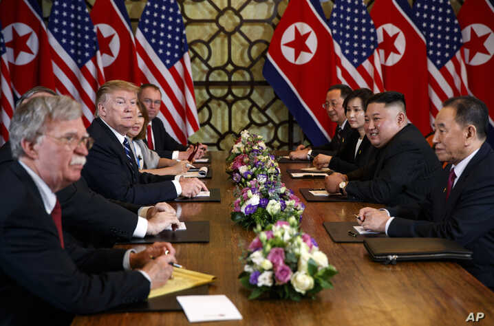 FILE - President Donald Trump speaks during a meeting with North Korean leader Kim Jong Un, in Hanoi, Vietnam, Feb. 28, 2019. At left is then-National Security Adviser John Bolton.
