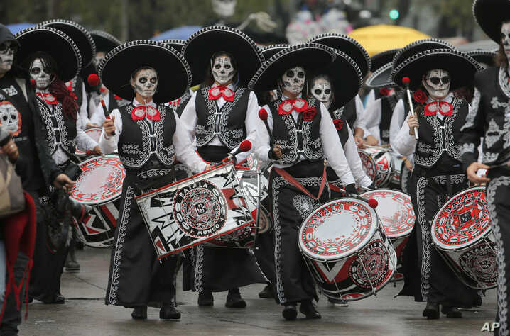Performers participate in the Day of the Dead parade in Mexico City, Saturday, Nov. 2, 2019.