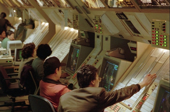 Staffers at the Civil Aeronautics Administration's flight control tower center ensure flight safety as some 300 flights have to…
