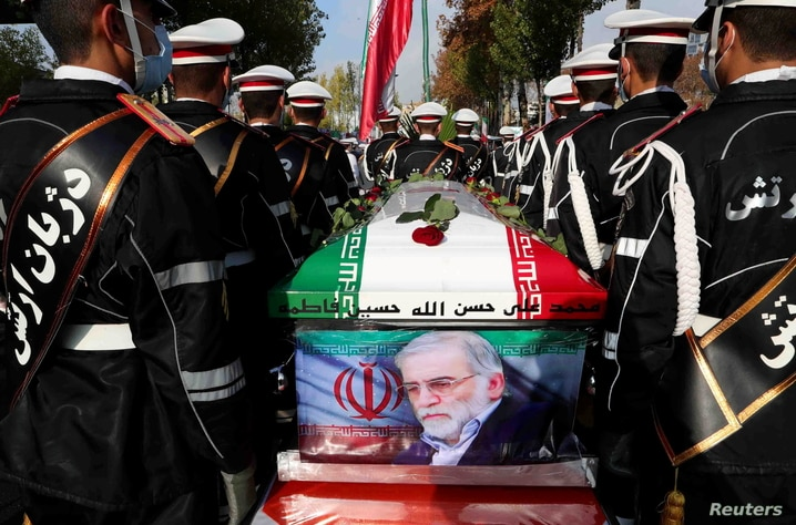 Members of Iranian forces carry the coffin of Iranian nuclear scientist Mohsen Fakhrizadeh during a funeral ceremony in Tehran,…