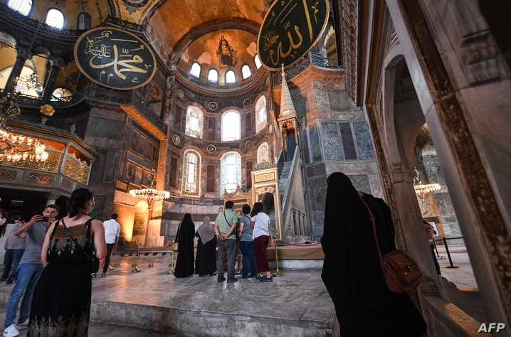 Tourists visit the inside of Hagia Sophia on July 10, 2020, in Istanbul, before a top Turkish court revoked the sixth-century…