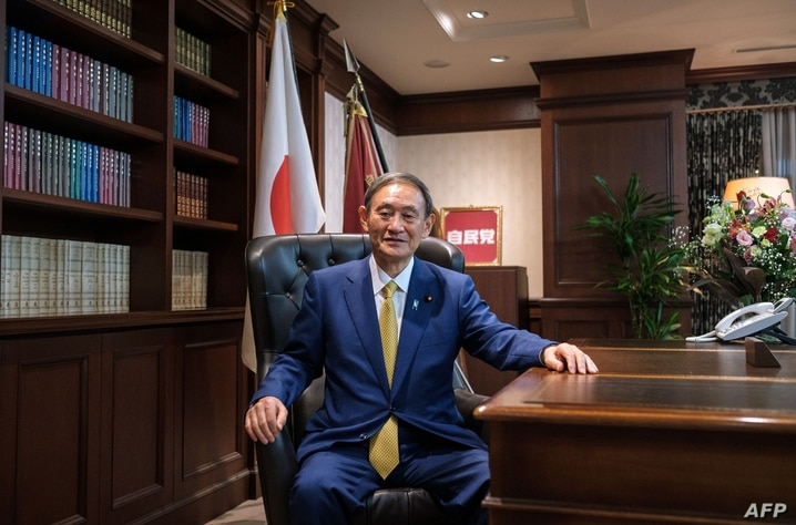 Newly elected leader of Japan's Liberal Democratic Party (LDP) Yoshihide Suga poses for a portrait at his office following a…