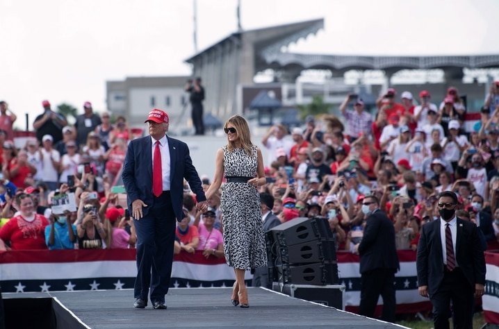 TOPSHOT - US President Donald Trump and US first lady Melania Trump leave after speaking during a Make America Great Again…