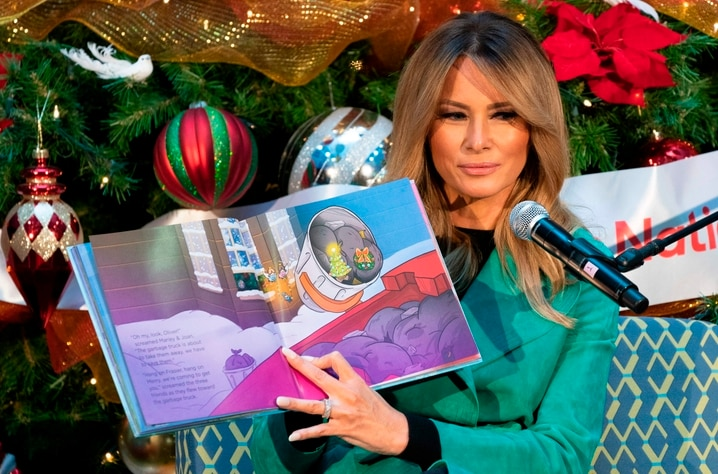 First lady Melania Trump reads a Christmas book to children who are patients at Children's National Hospital on December 15,…