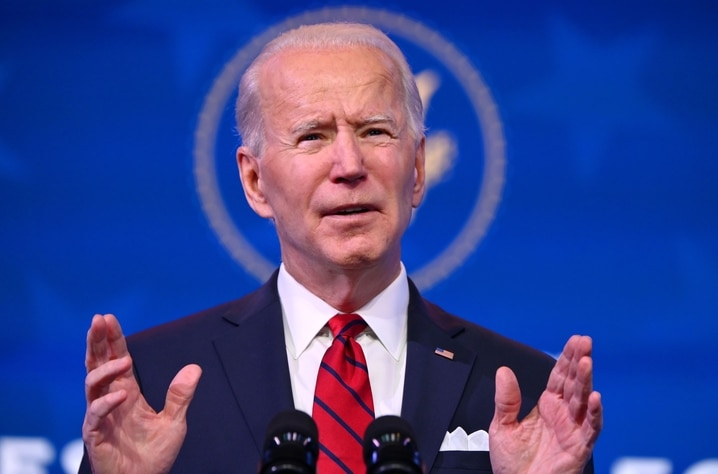US President-elect Joe Biden delivers remarks on his plan to administer Covid-19 vaccines at The Queen theater in Wilmington,…