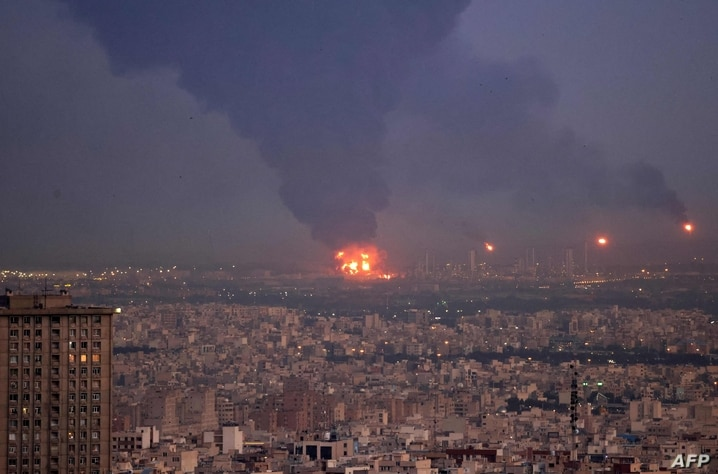 TOPSHOT - A picture taken on June 2, 2021, shows smoke billowing from the site of a refinery fire in the Iranian capital Tehran…