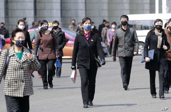 Pedestrians wear face masks to help prevent the spread of the coronavirus, Wednesday, April 1, 2020, in Pyongyang, North Korea…