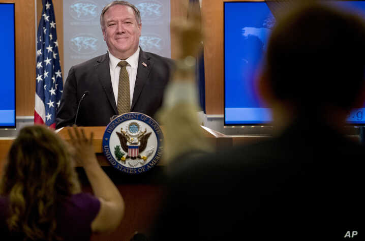 Secretary of State Mike Pompeo takes a question from a reporter during a news conference at the State Department in Washington,…
