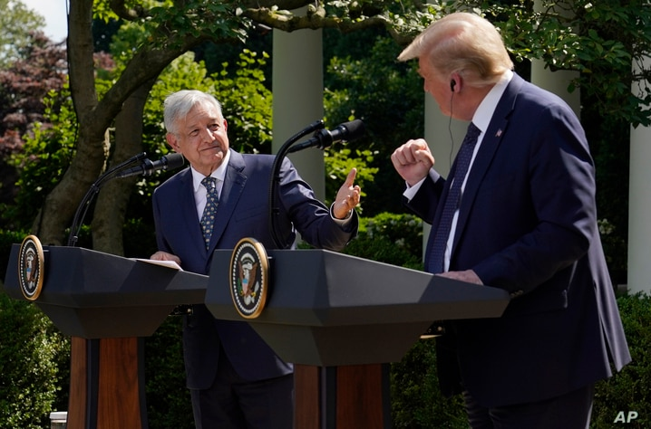 President Donald Trump and Mexican President Andres Manuel Lopez Obrador gesture before signing a joint declaration at the…
