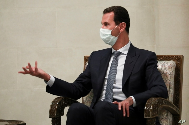 FILE - In this Monday, Sept. 7, 2020 file photo released by Russian Foreign Ministry Press Service, Syrian President Bashar al…