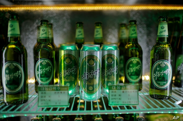 In this Wednesday, July 26, 2017, photo, samples of different types of Taedonggang beer are displayed in a refrigerator at the…